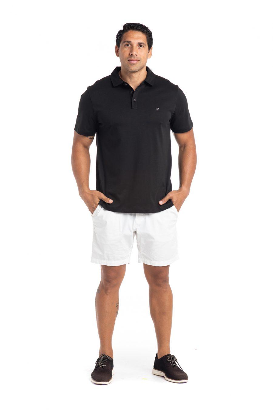 Male model wearing Waikii Polo in Black - Front View