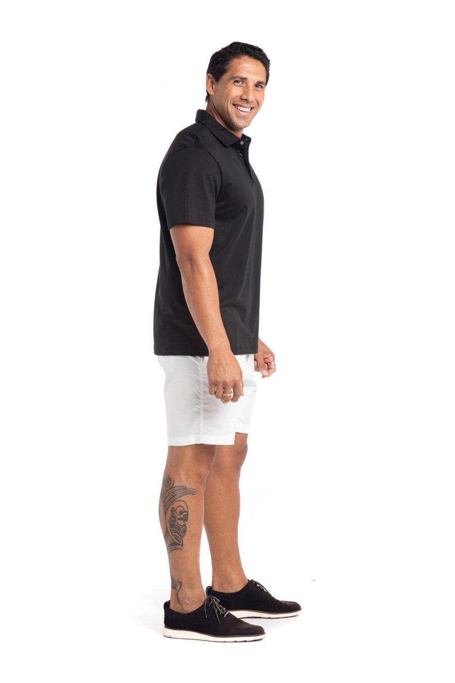 Male model wearing Waikii Polo in Black - Side View