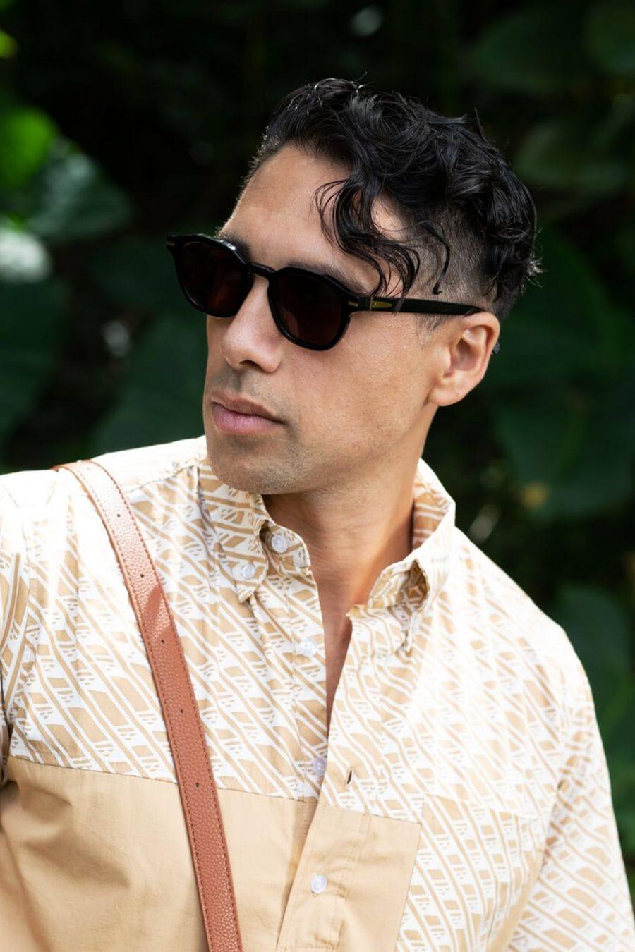 Male model wearing Hegias Black Sunglasses