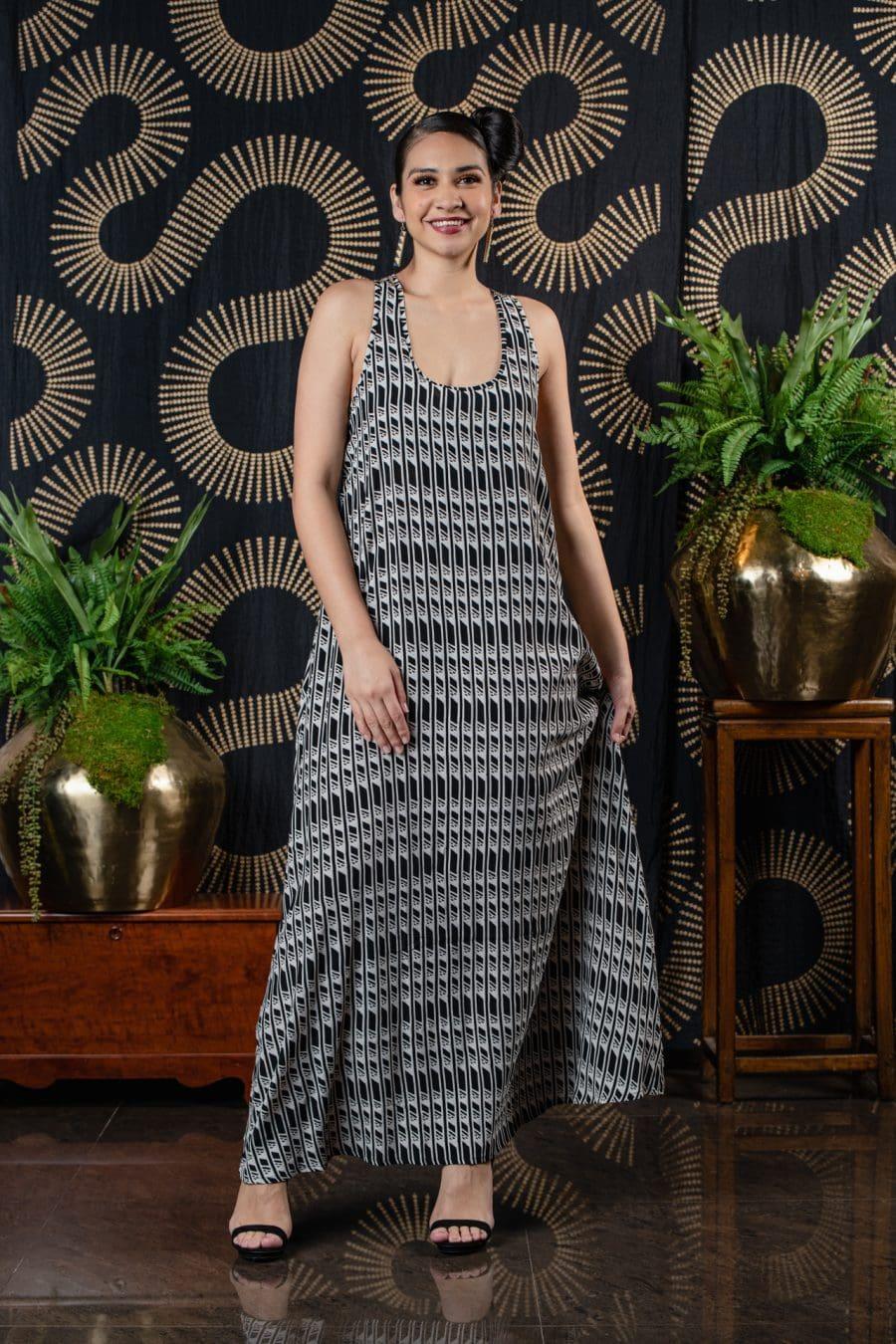 Model wearing Kaimanahila Long Dress in Black Chime Hulunene - Front View
