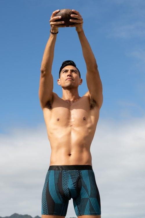 Male model wearing Manaola Boxer Brief in Blue Sapphire Kanaloa
