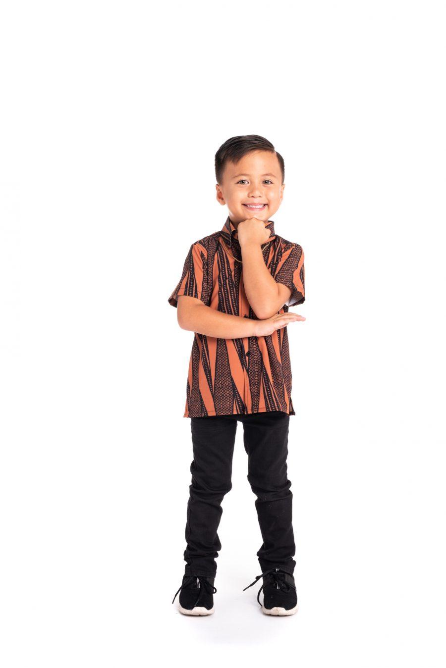Boy wearing Keiki Mahalo Shirt S-S in Kialoa Copper Brown
