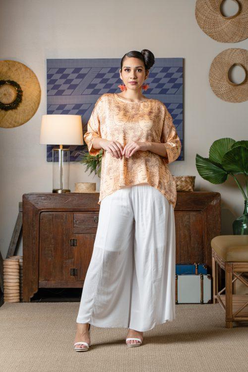 Model wearing Maunaloa in Apricot Sherbert/Gingersnap Kaleilehua - Front View