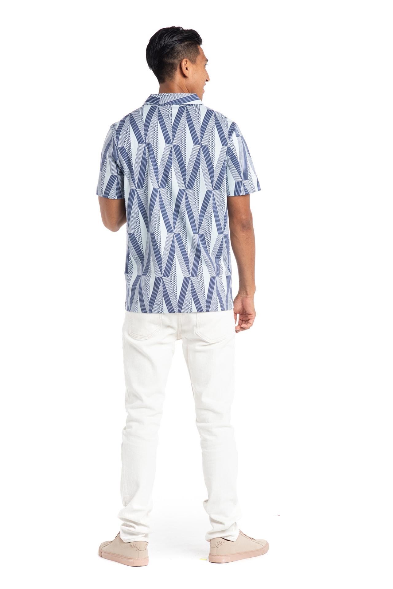 Male model wearing Waikii Polo in Kanaloa - Back View
