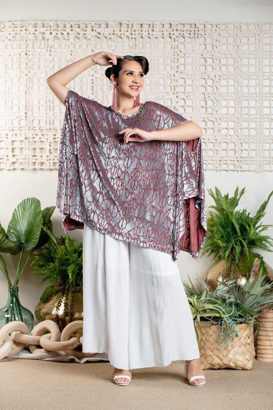Model wearing Kipuka Poncho in Frosted Plum