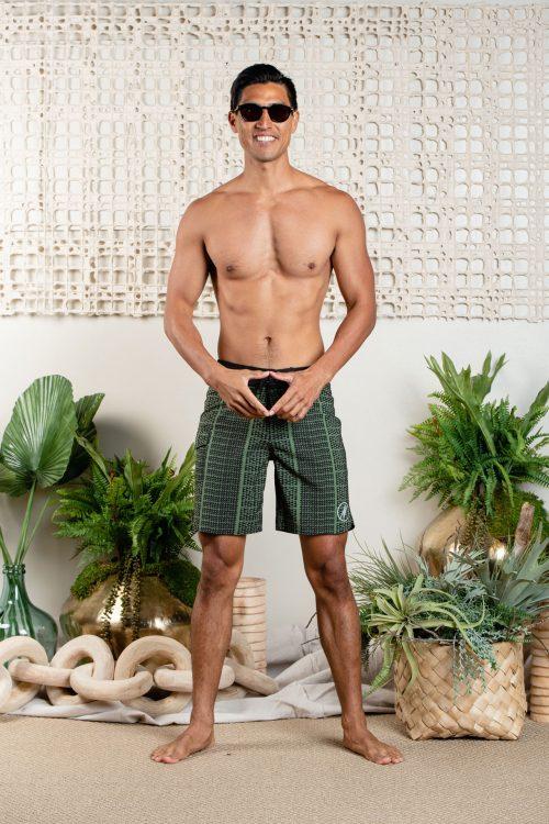 Male model wearing 4-way stretch in Nihoku- Green