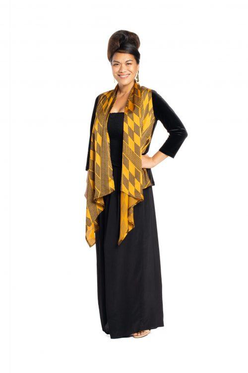 Model wearing Kaulu Sweater in Kamehameha Pattern