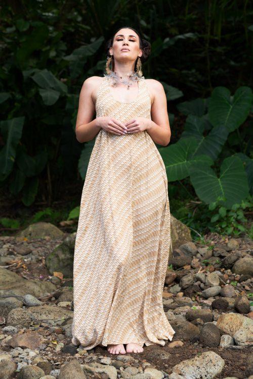 Model wearing Kaimanahila Long Dress in Tannin Moonbeam Hulunene - Front View