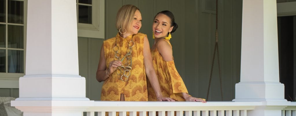 Models wearing bright gold clothing