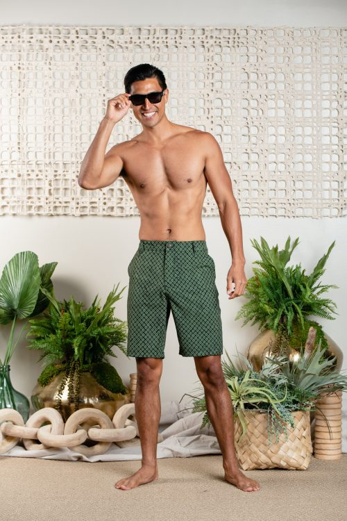 Male model wearing 4 Way Stretch Bottoms in Black/Green Olive - Front View