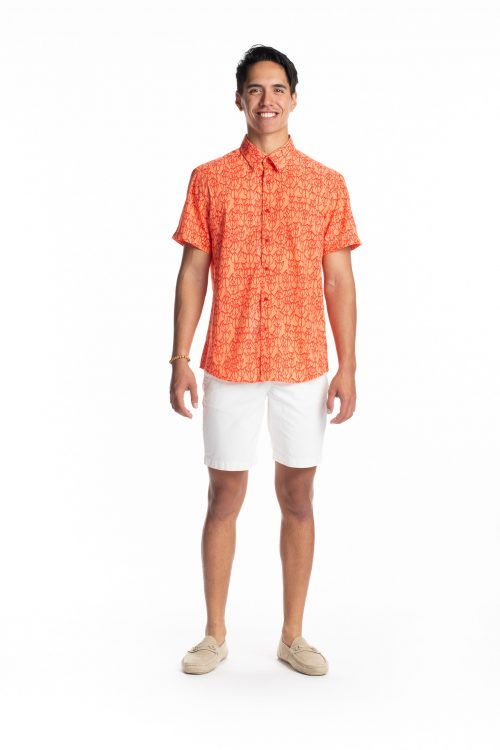 Male model wearing Hula Shirt S-S in Musk Melon/Firey Red Kapualiko - Front View