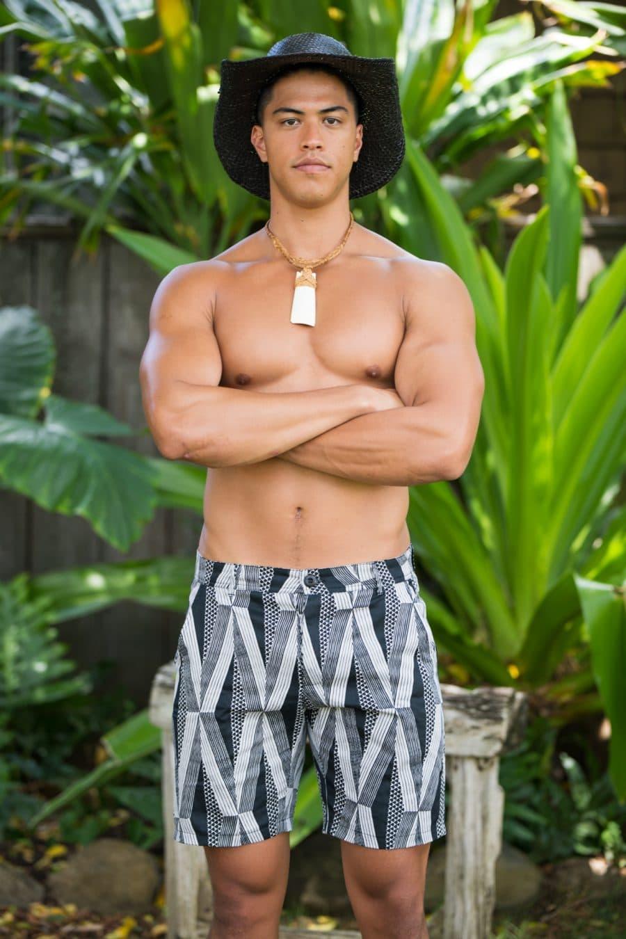 Male model wearing Keola Shorts in Black Windchime Kanaloa Pattern - Front View