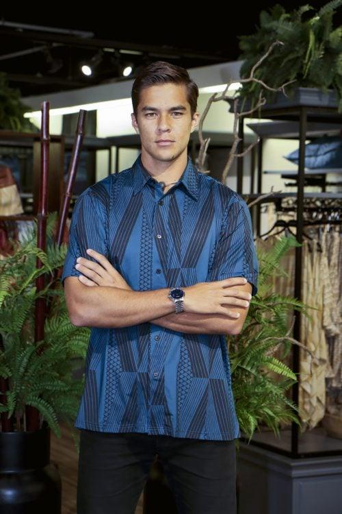 Male model wearing Golf Aloha Button in Blue Sapphire Black Kanaloa Pattern - Front View