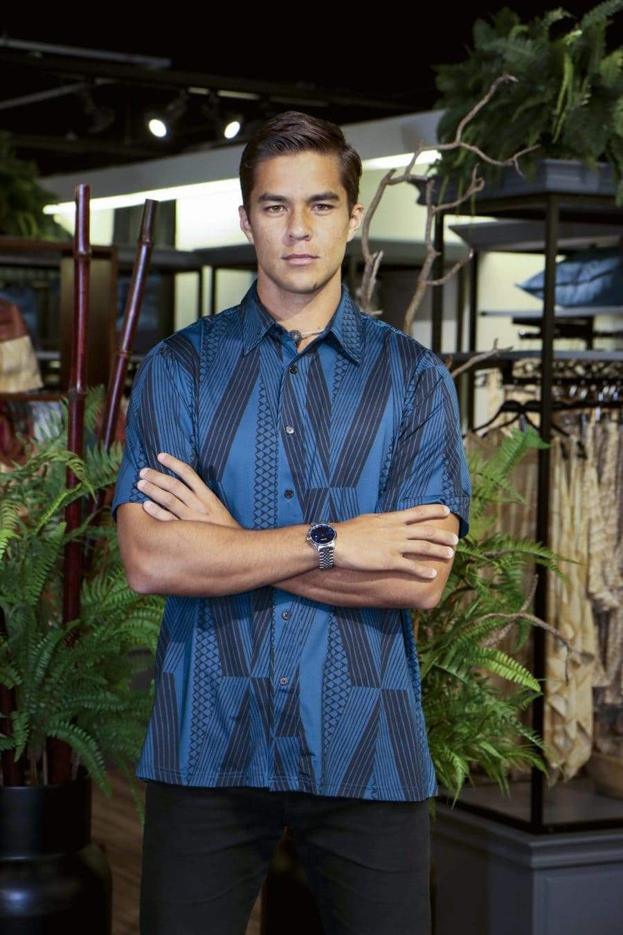 Male model wearing Golf Aloha Button in Blue Sapphire Black Kanaloa Pattern - Front View
