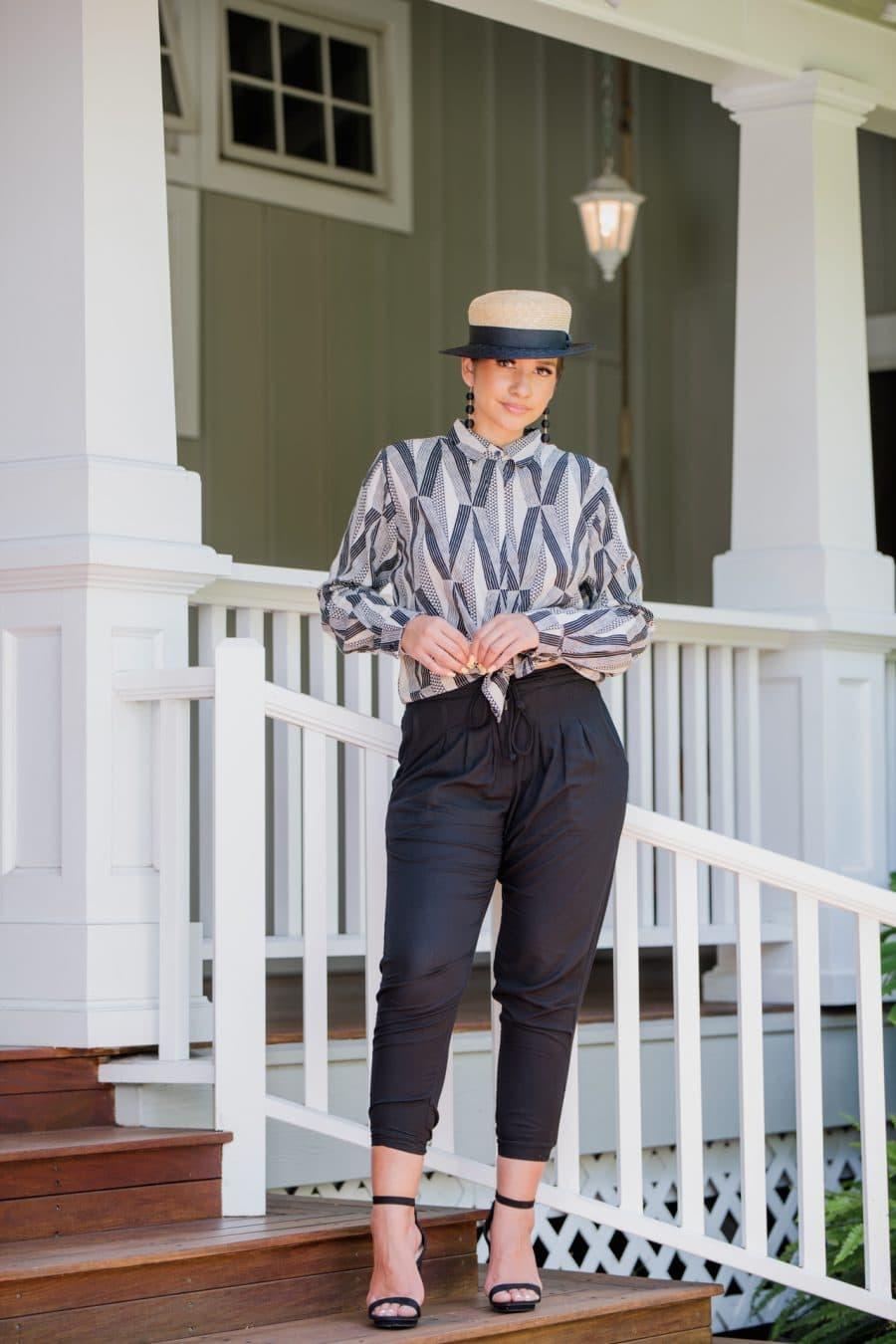 Model Wearing Top Sexetary in Windchine Black Kanaloa Pattern - Front View