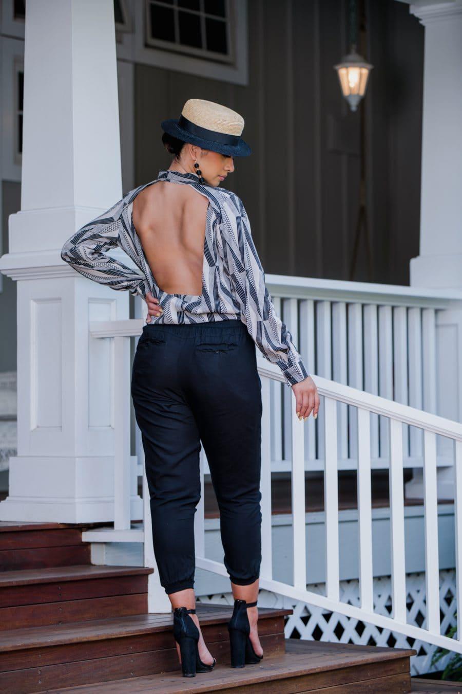 Model Wearing Top Sexetary in Windchine Black Kanaloa Pattern - Back View