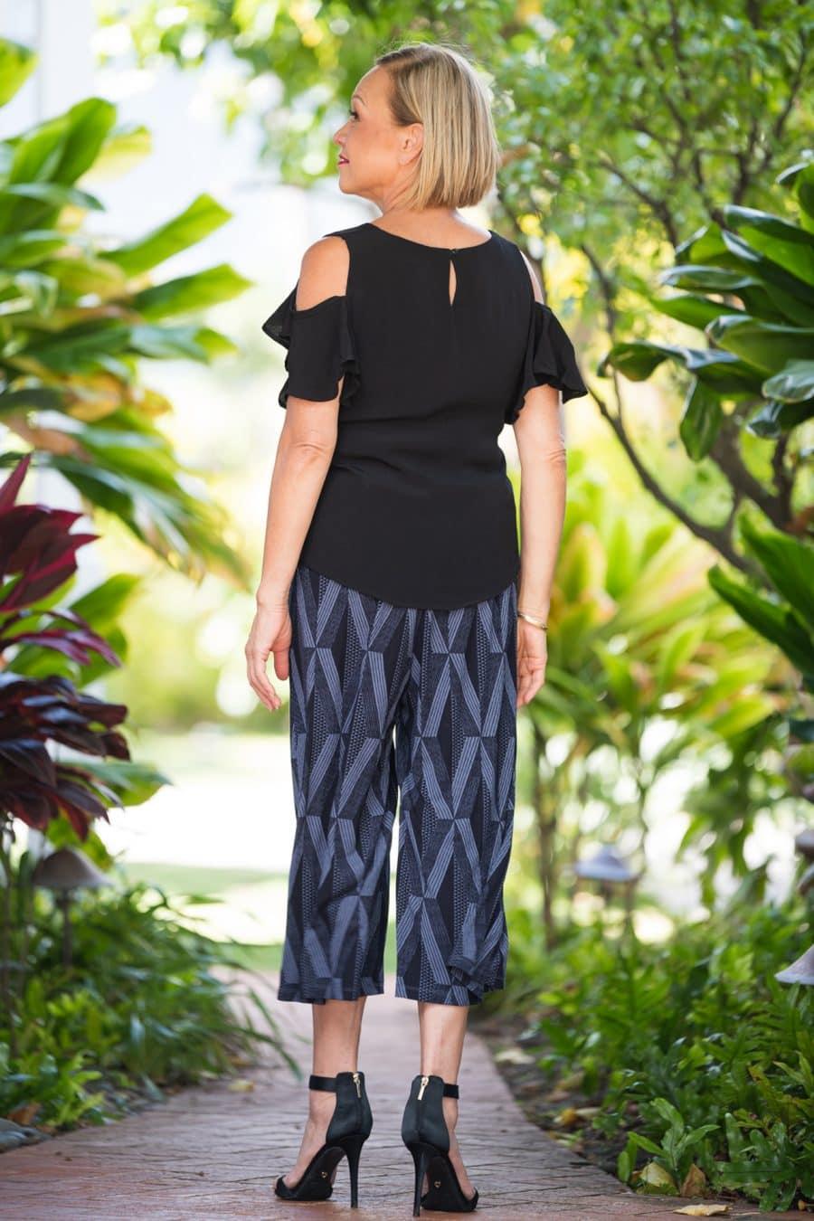 Model wearing Kalei Kulots in Deepwell Folkstone Grey Kanaloa Pattern - Back View