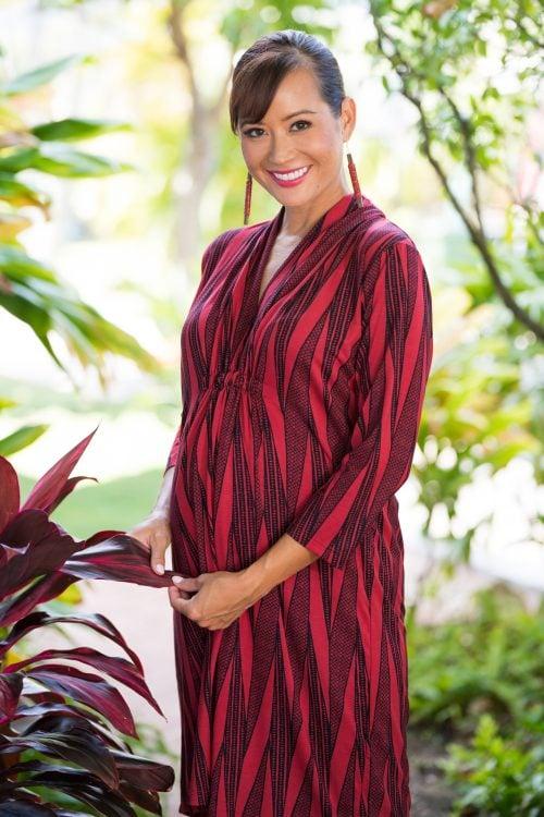 Model wearing Laulena Short Dress in Brick Red Deepwell Kialoa Pattern - Front View