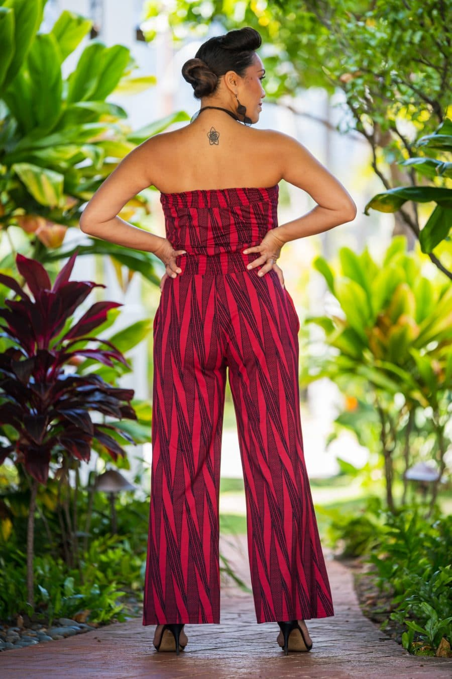Model wearing Pakalana Jumpsuit in Brick Red Deepwell Kialoa Pattern - Back View