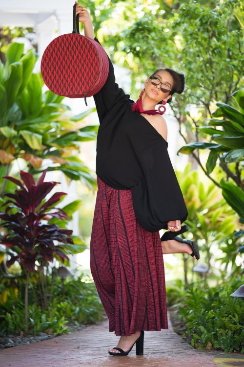 Model wearing Huakai Pant in Deepwell Brick Red Nihoku Pattern - Front View