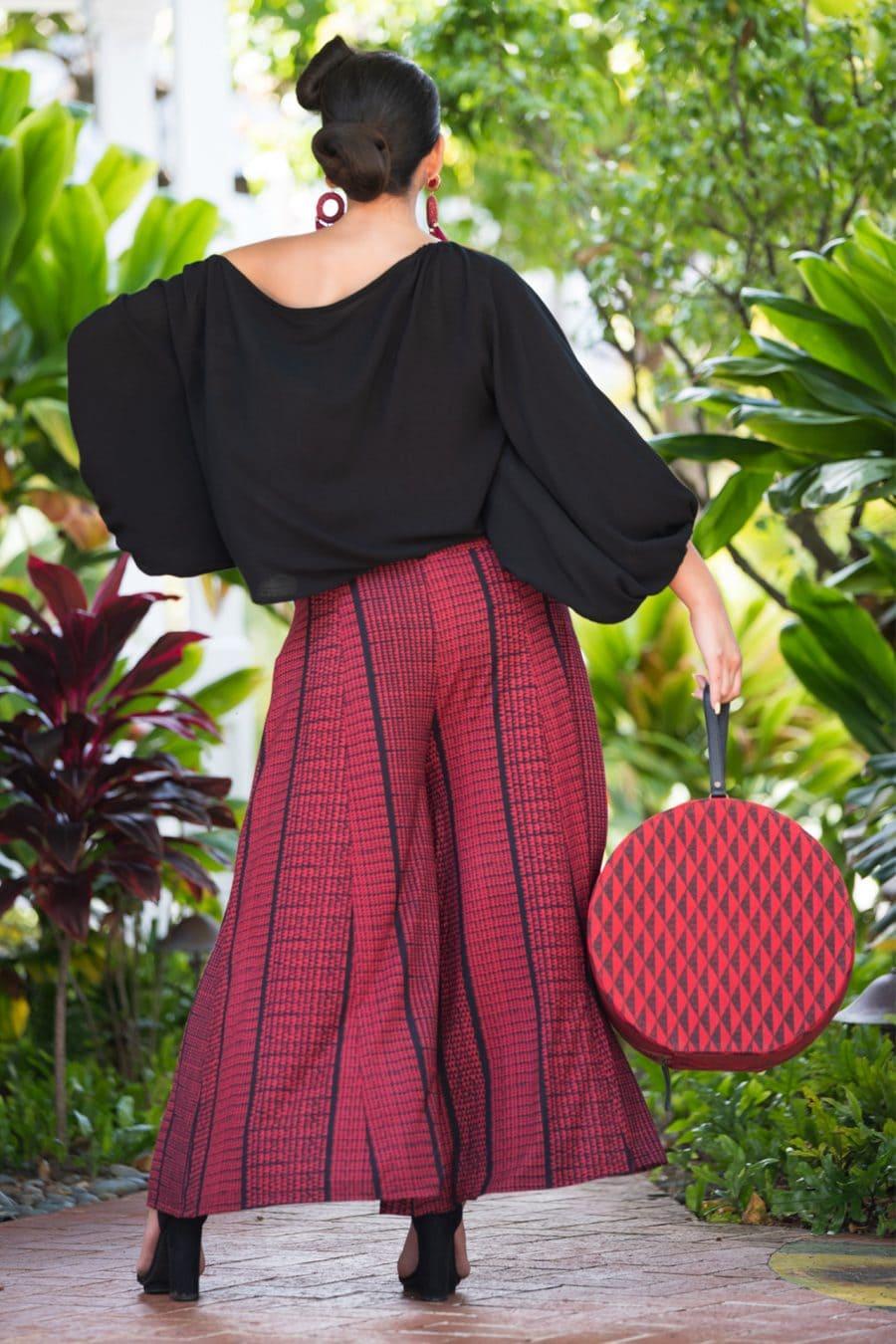 Model wearing Huakai Pant in Deepwell Brick Red Nihoku Pattern - Back View