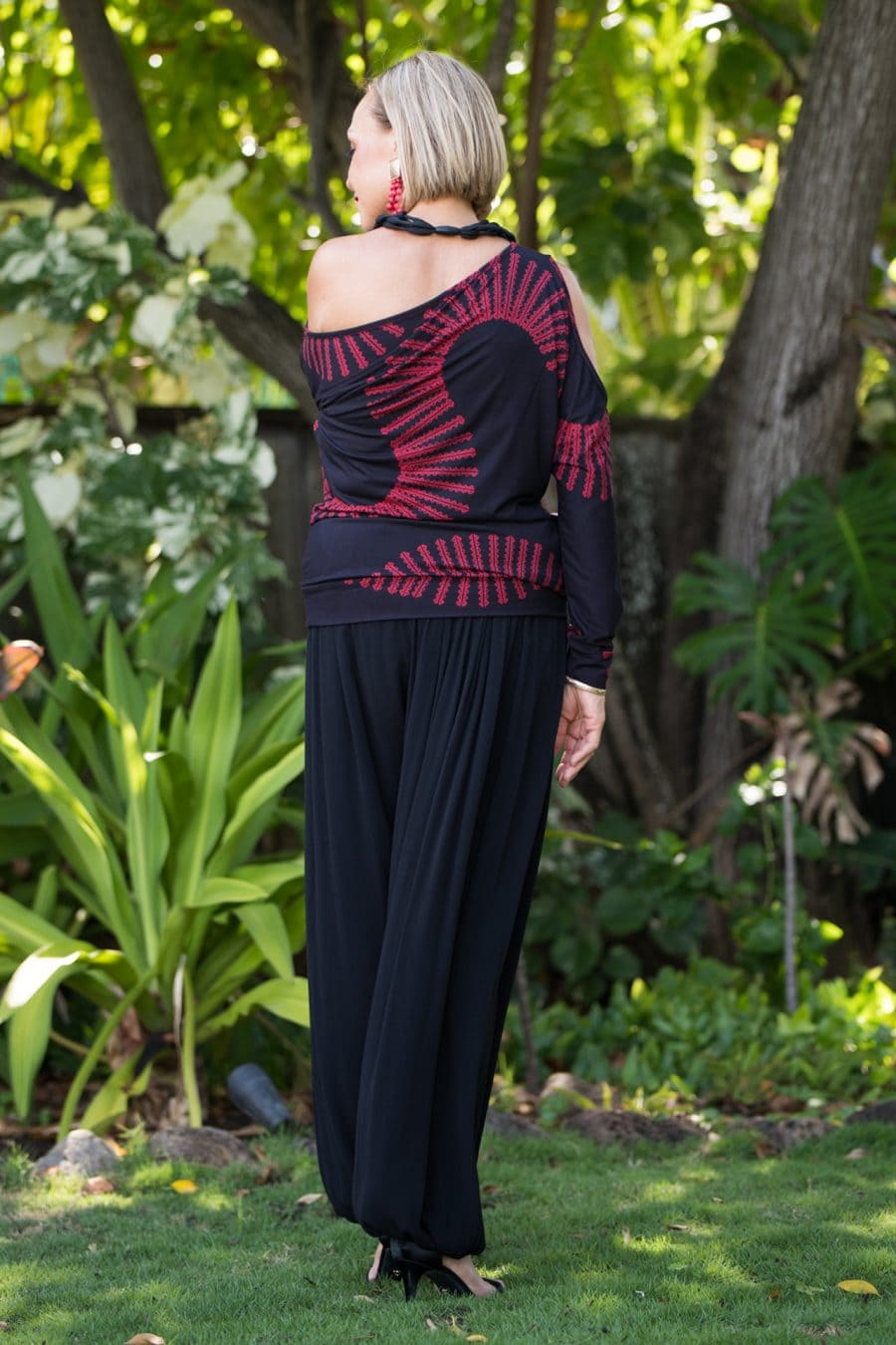 Model wearing Kipoohiwi Top in Deepwell Brick Red Lalani Kalalea Pattern - Back View