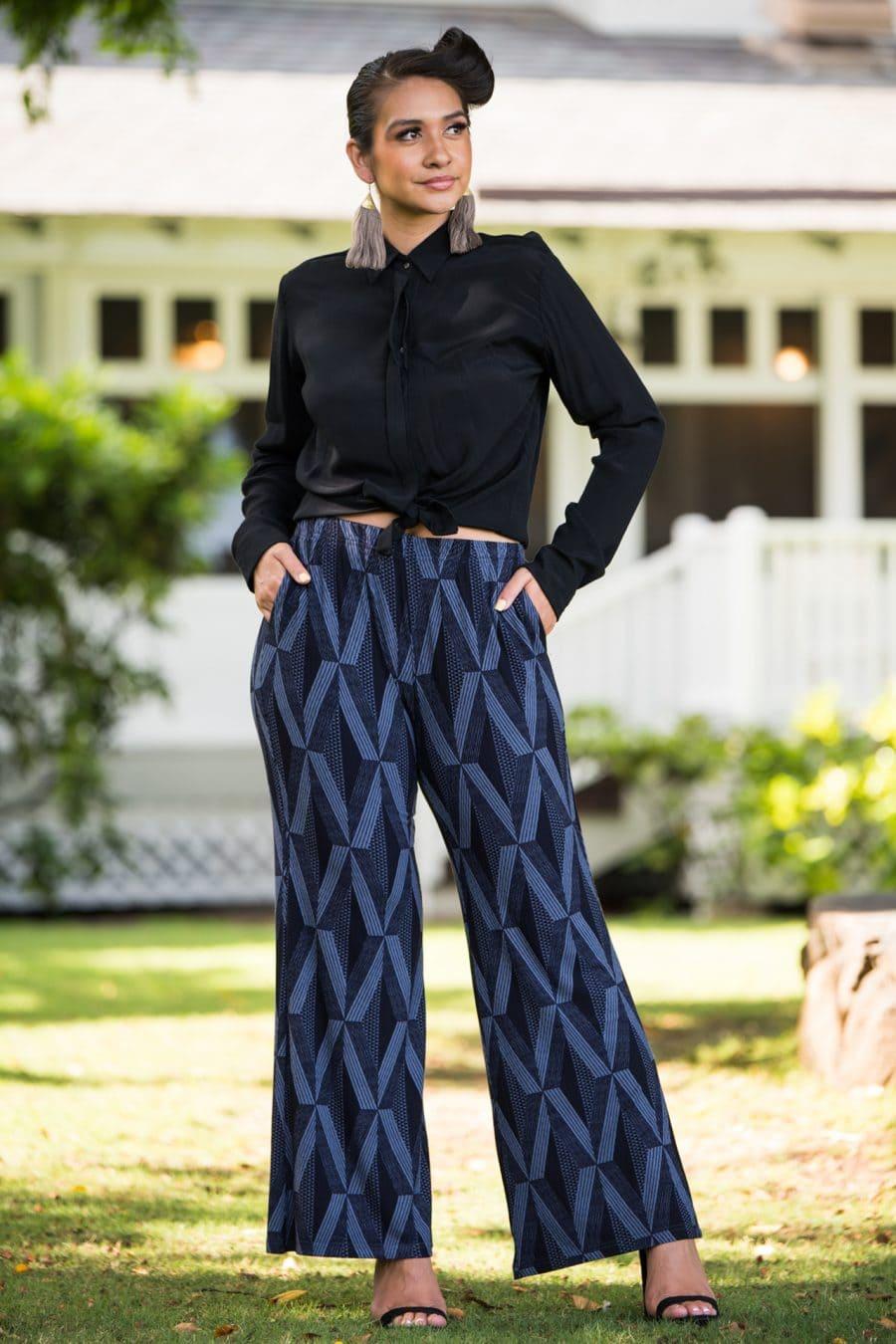 Model wearing Awapuhi Pant in Deepwell Folkstone Grey Kanaloa Pattern - Front View