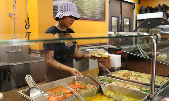 DaSpot worker serving food