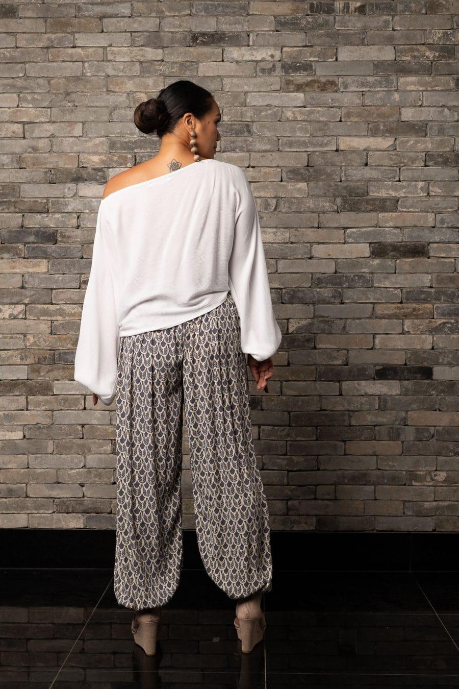Model wearing Waioli Pant in Pavement Moonbeam Palulu Pattern - Back View