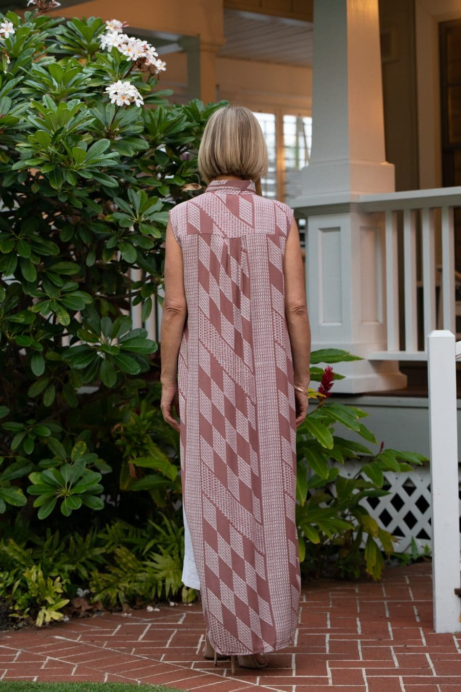 Model wearing Hualalai Top in Fired Brick White Kamehahema Pattern - Back View