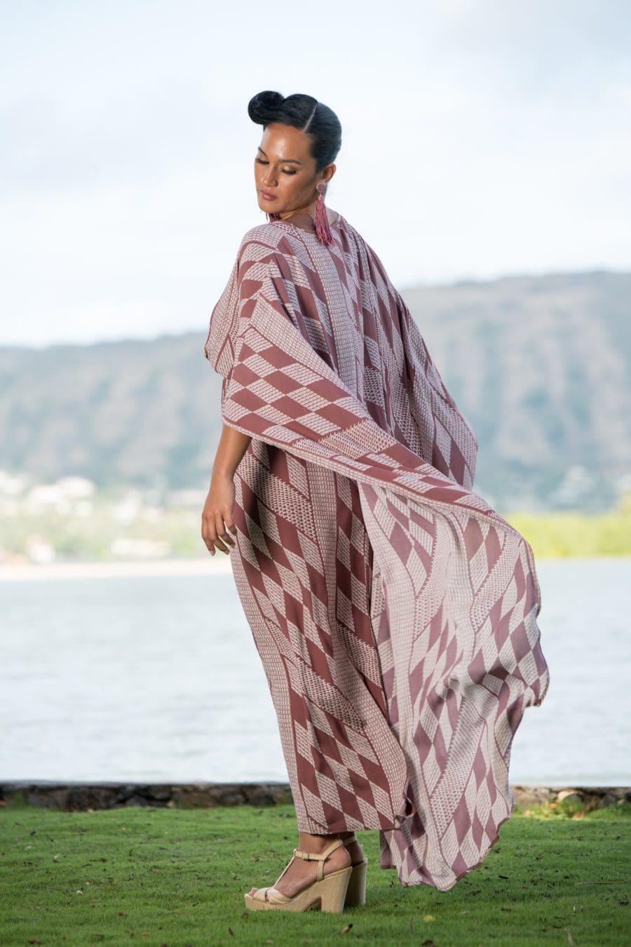 Model wearing Manu O'O Dress in Fired Brick-White Kamehameha Pattern - Back View