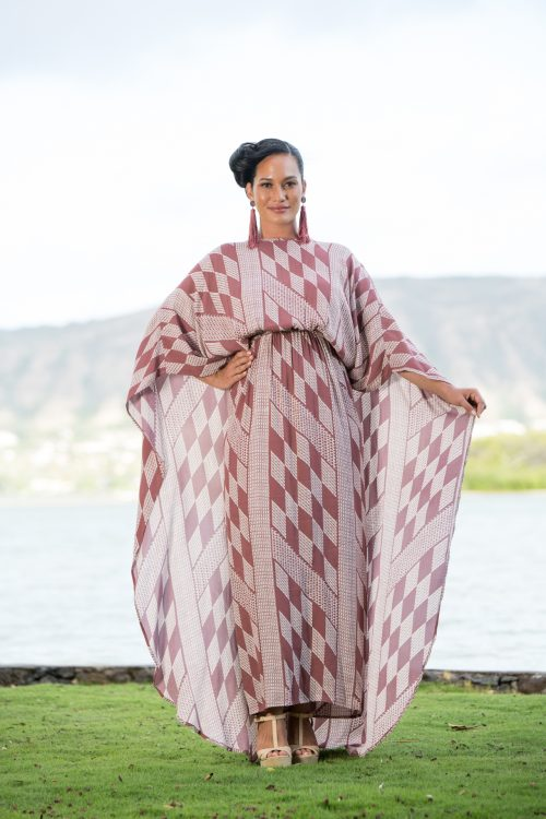 Model wearing Manu O'O Dress in Fired Brick-White Kamehahema Pattern - Front View