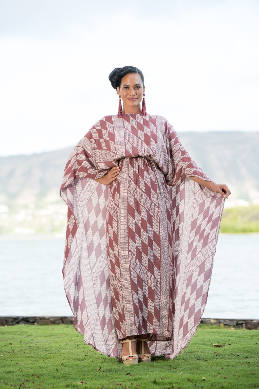 Model wearing Manu O'O Dress in Fired Brick-White Kamehahema Pattern - Front View