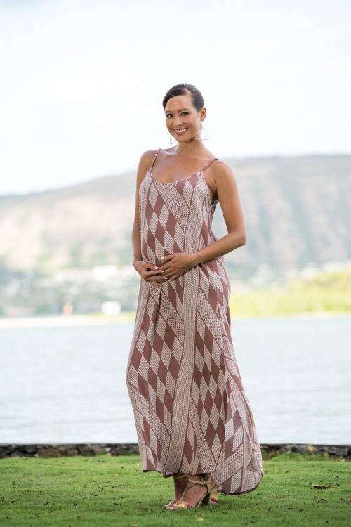 Model wearing Uluniu Maxi Dress in Fired Brick White Kamehameha Pattern - Front View