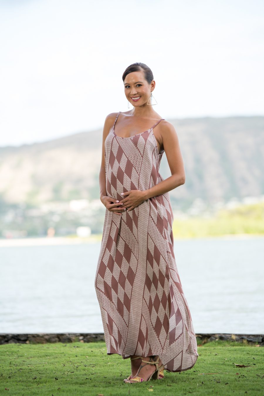 Model wearing Uluniu Maxi Dress in Fired Brick White Kamehameha Pattern - Front View