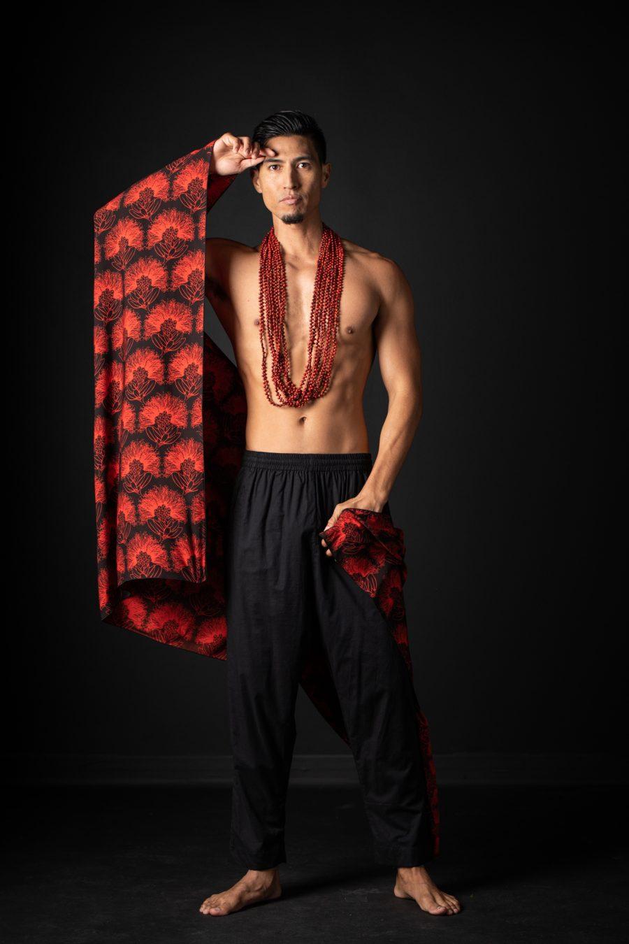 Model wearing Pareo shawl in Firey Red Black Kalihilehua Pattern