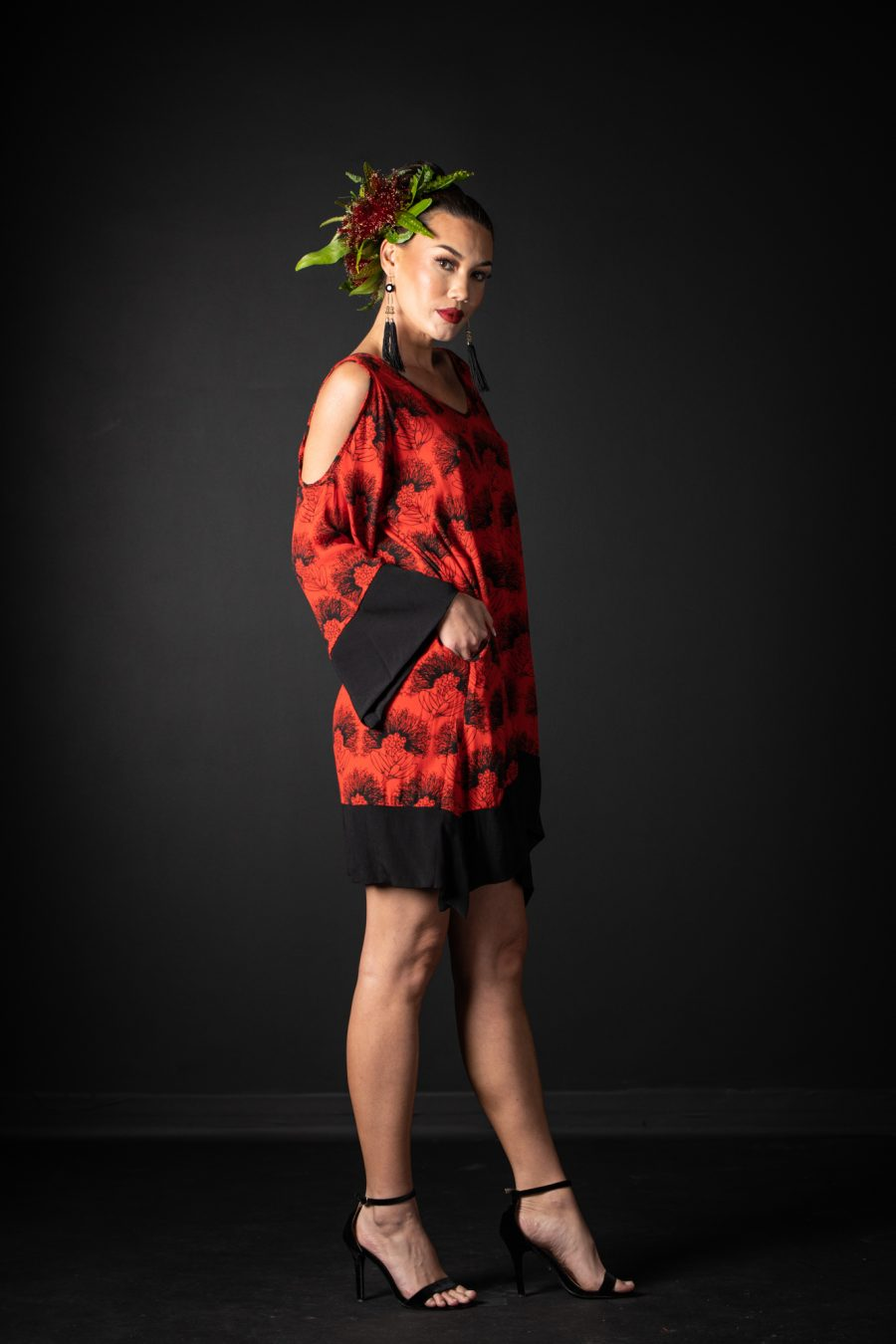 Model wearing Kamakana Top with Pocket in Firey Red-Black Kalihilehua Pattern - Side View