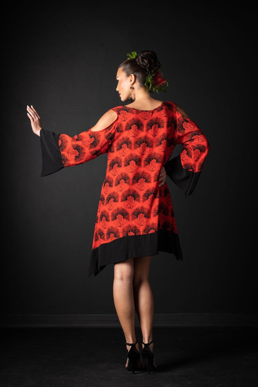 Model wearing Kamakana Top with Pocket in Firey Red-Black Kalihilehua Pattern - Back View