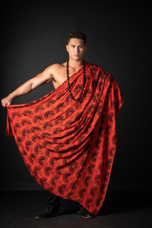 Model wearing Pareo shawl in Firey Red Black Kalihilehua Pattern