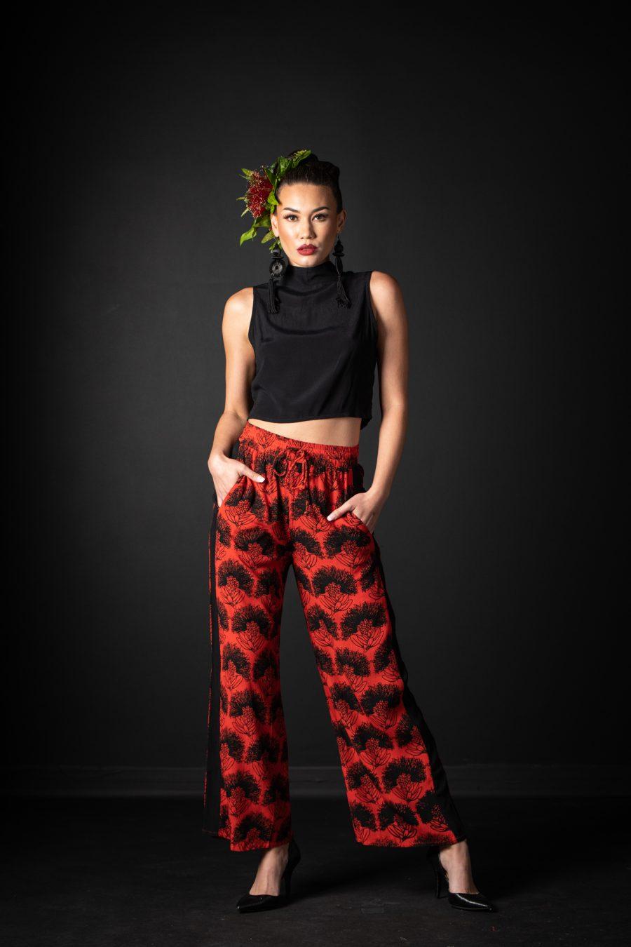 Model wearing Ola Pant in Firey Red Black Kalihilehua Pattern