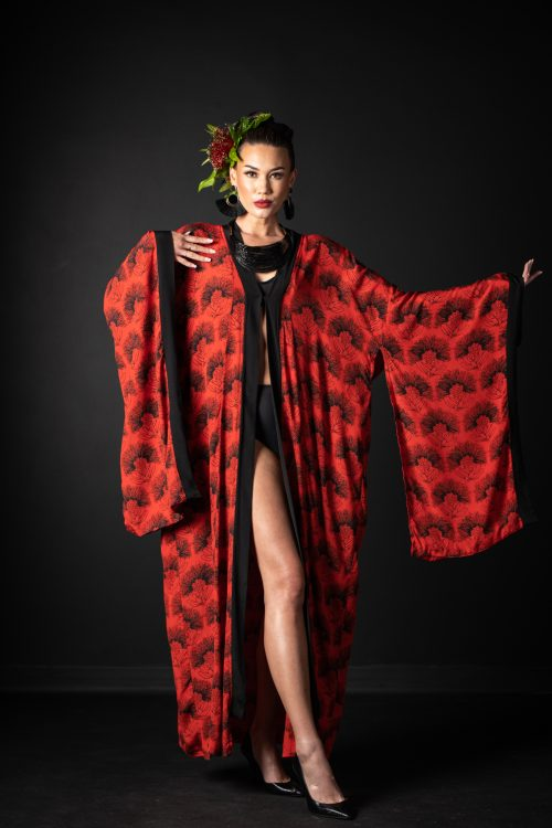Model wearing Kaliko Kaftan in Firey Red Black Kalihilehua Pattern