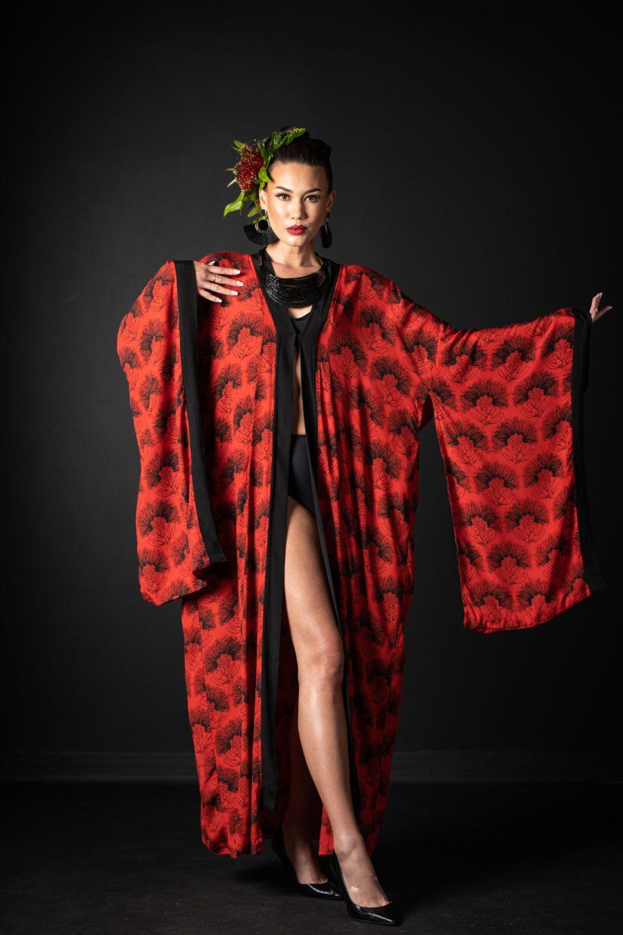 Model wearing Kaliko Kaftan in Firey Red Black Kalihilehua Pattern