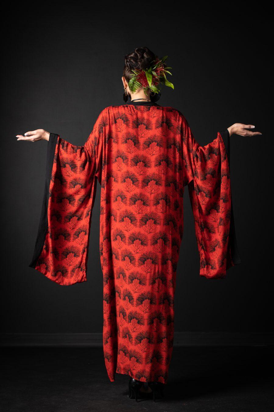 Model wearing Kaliko Kaftan in Firey Red Black Kalihilehua Pattern - Back View