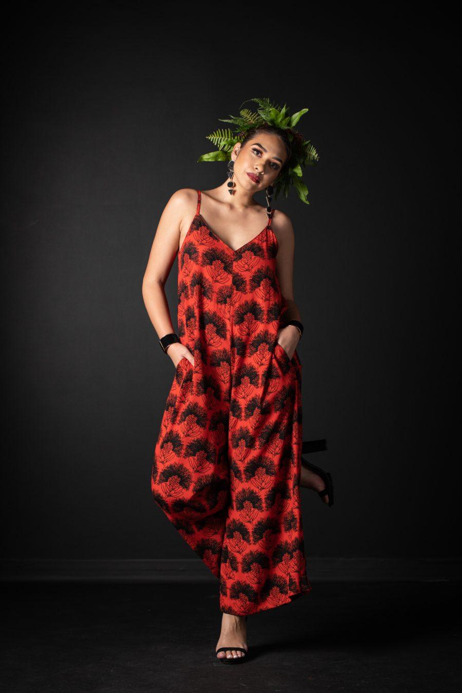 Model wearing LANIHAU JUMPSUIT in Firey Red Black Kalihilehua Pattern - Front View