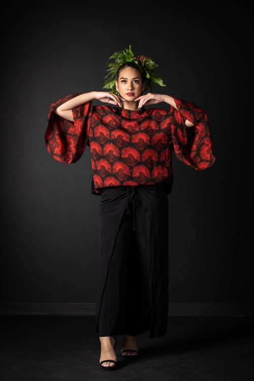 Model wearing Hoolaulea Top in Firey Red Black Kaleilehua Pattern - Front View