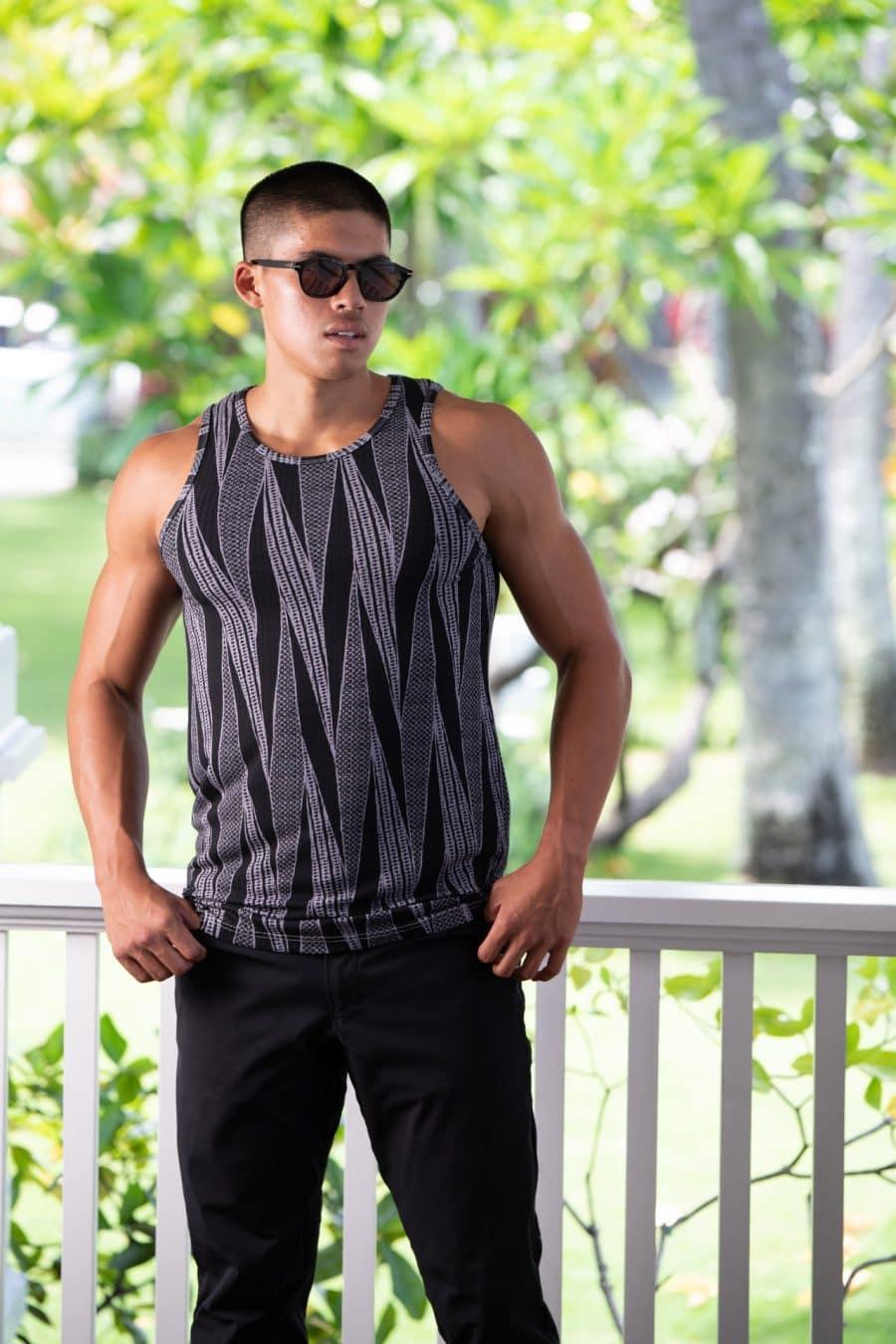 Male model wearing Kawelo Ribbed Tank in Jet Black Silver Filigree Kialoa Pattern - Front View
