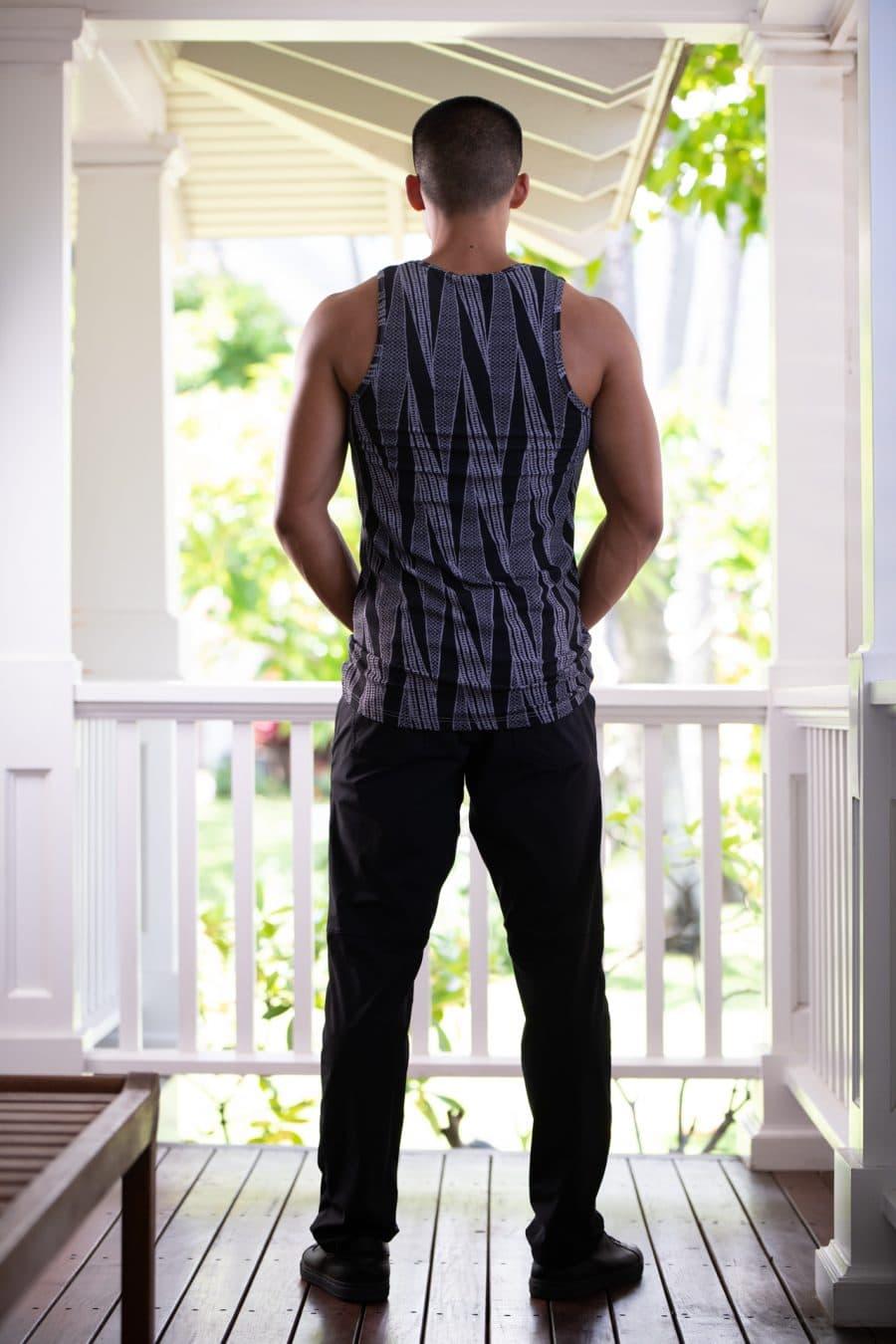 Male model wearing Kawelo Ribbed Tank in Jet Black Silver Filigree Kialoa Pattern - Back View