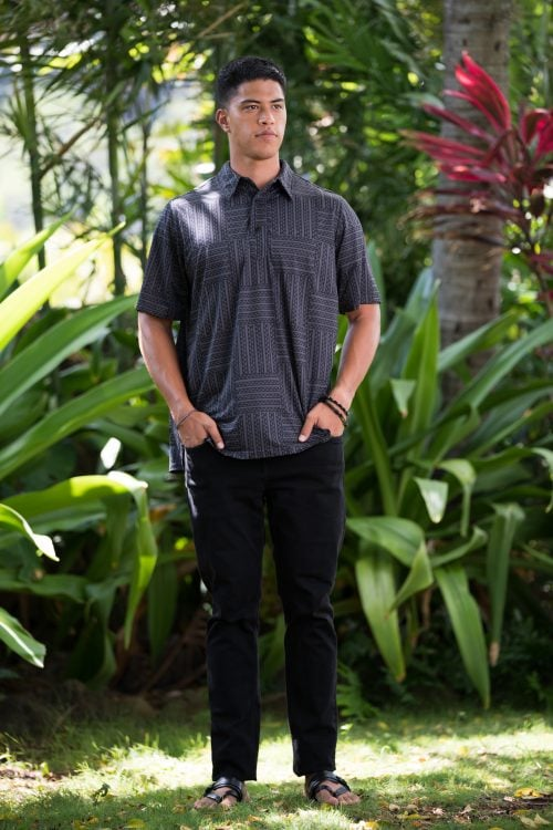 Male model wearing Golf Aloha Button Shirt in Blackened Pearl Black Ulana Pattern - Front View