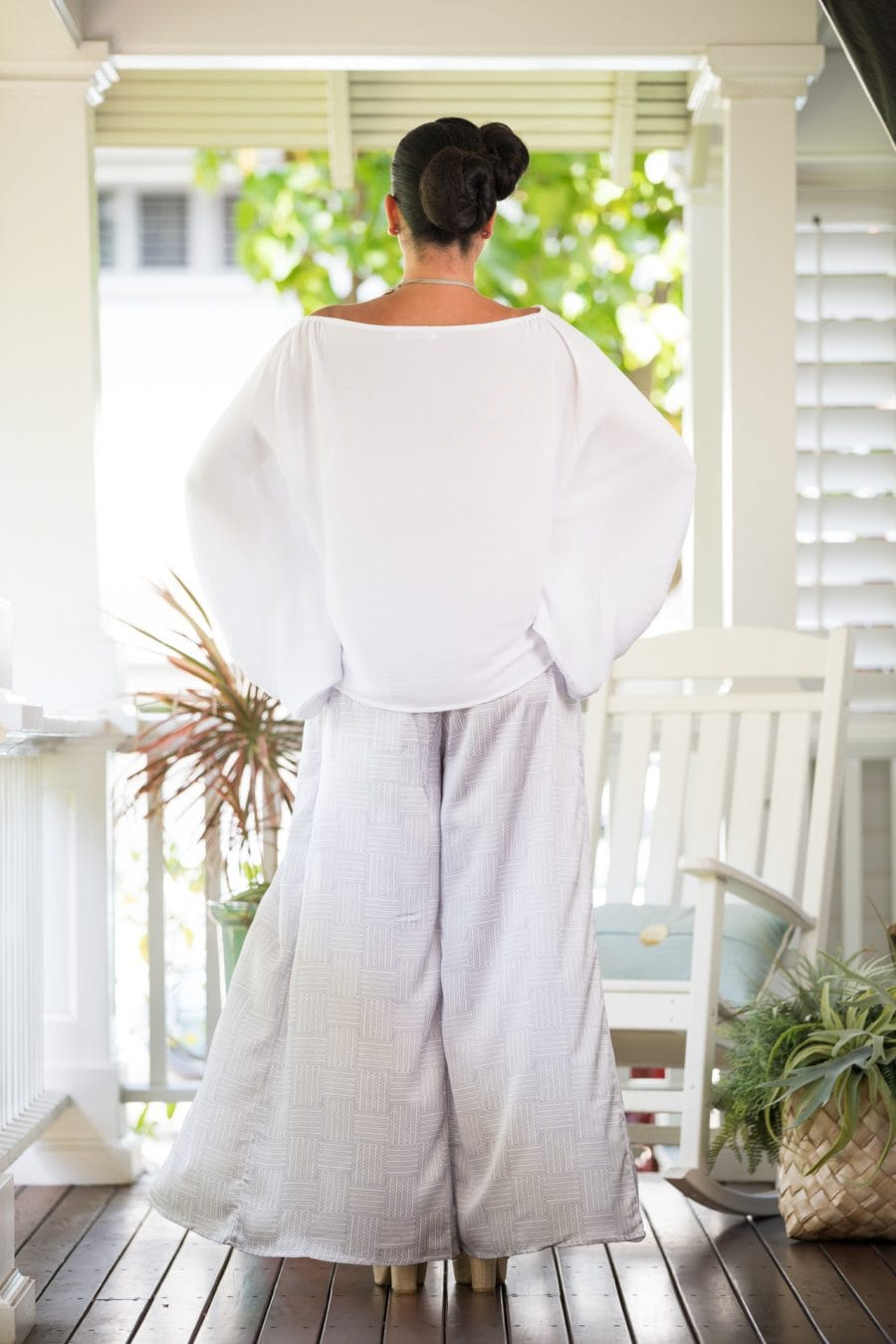 Model wearing Hapuna Pant in Blanc De-Lilac Grey Ulana Pattern- Back View