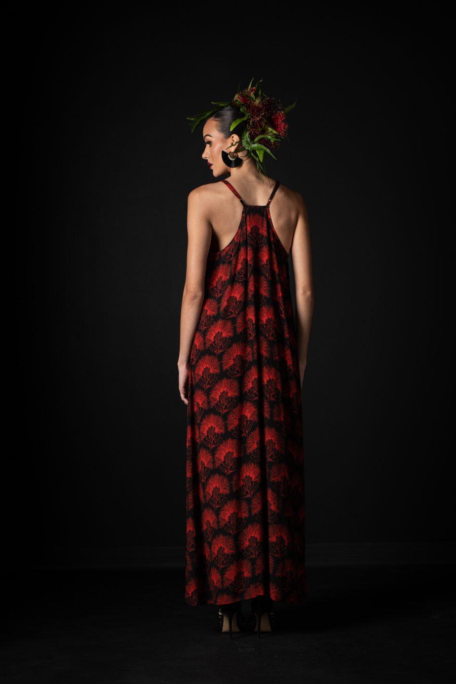 Model wearing Lanihau Dress in Black Fiery Red Kalihilehua Pattern- Back View